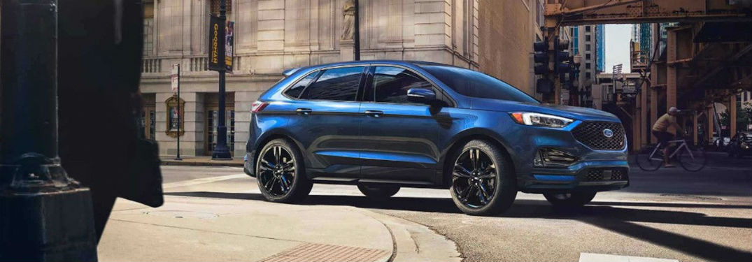 Ford Edge Exterior Front Fascia And Passenger Side On City Road With Person Biking